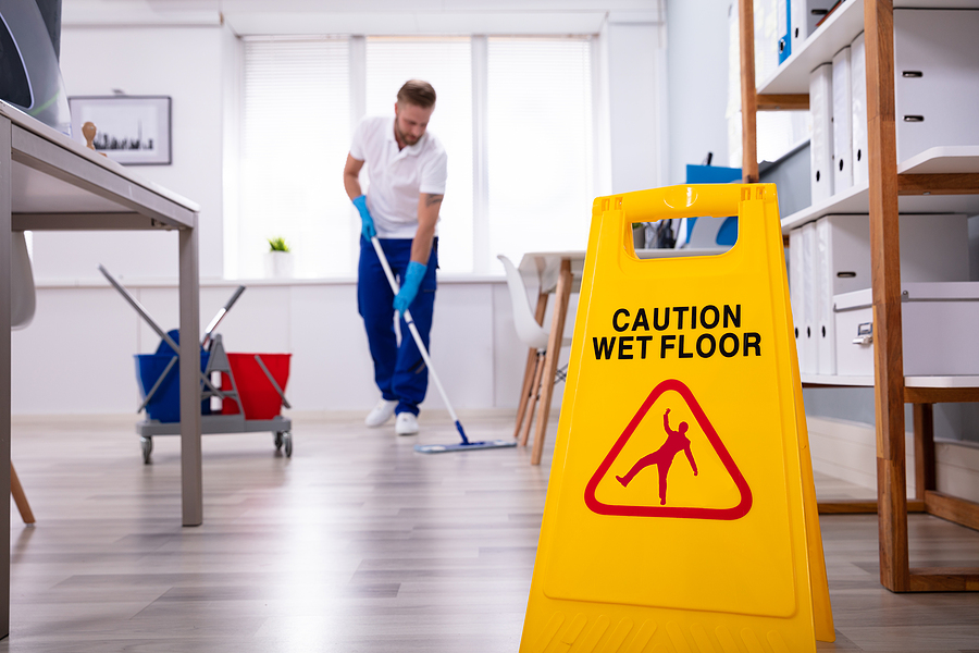 Office cleaners in Sydney mopping the floor